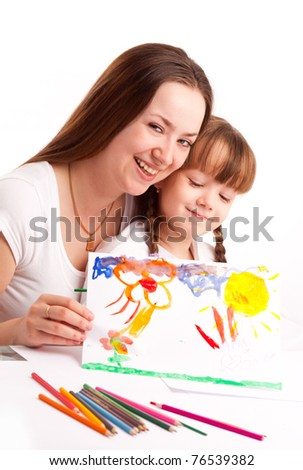 young mother and her five year old daughter drawing with pencils and watercolor at home