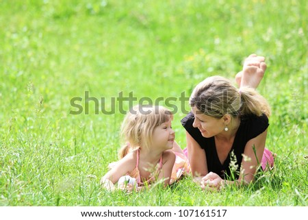 young mother and her little daughter on the nature