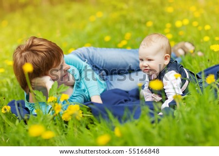 young mother and looking at daughter outdoors