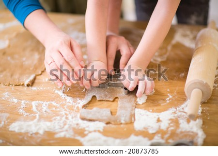 Young mother and son in kitchen making cookies. #20873785