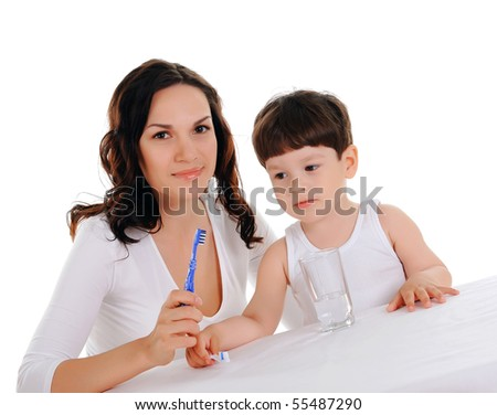 young mother and the little boy brushing teeth