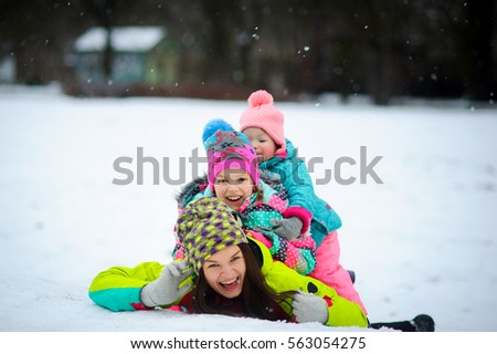 Young Mother And Two Of Her Little Daughters Have Put Up A Cheerful Fight On Snow