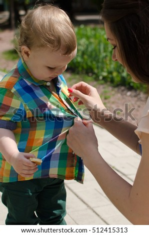 5e7abf7b8845 Free photos Changing clothes of the child