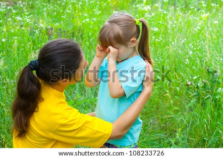 Young mother has conversations with daughter of preschool age