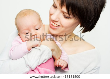 Young mother holding her baby - stock photo