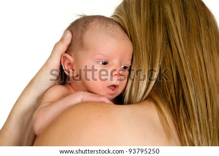 Young mother holding her 18 days old baby