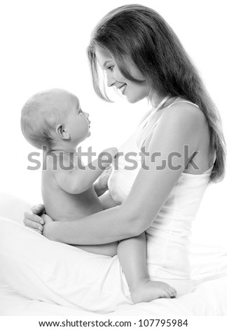 Young mother hugging baby - stock photo