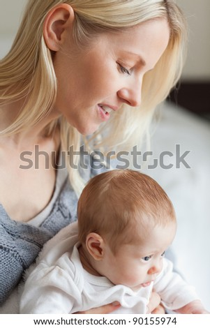 Young mother hugging her baby
