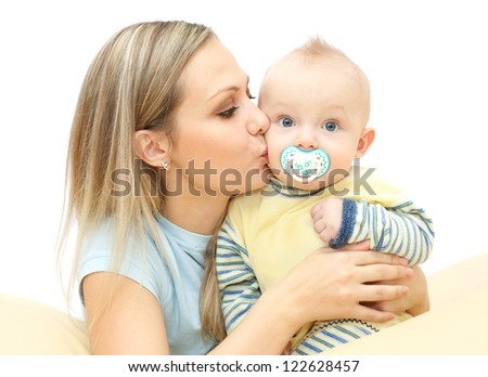 Young mother kisses and hugging baby