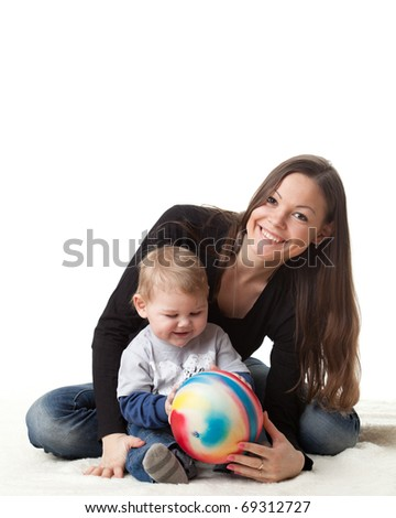 Young mother plays with her baby on a white background. Happy family.