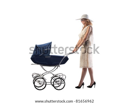 Young mother pushing a pram
