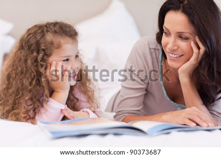 Young mother reading a bedtime story for her daughter