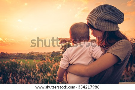 young mother standing near a...