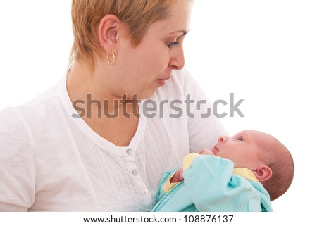 Young mother talking to her baby and making faces