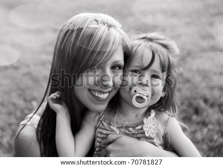 Young mother with child outside on a summer day.Black and white