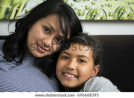 Young mother with her daughter. #696668395