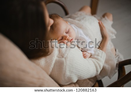 young mother with her newborn baby
