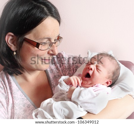 Young mother with her newborn baby. Close up with shallow DOF.