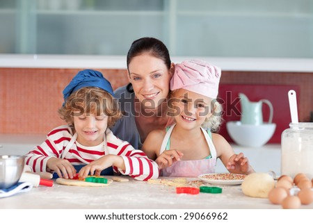 Young Mother with her Two Kids looking at the camera smiling
