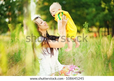 young mother with infant baby outdoors