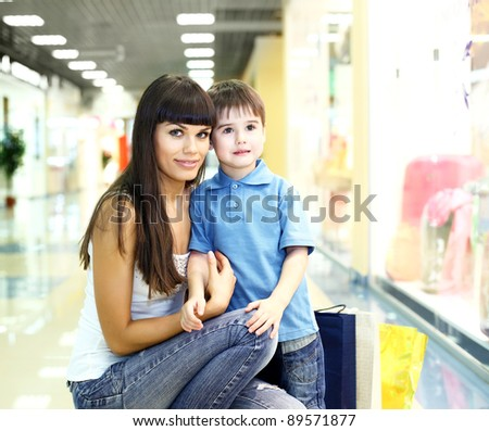 Young mother with shopping bags doing shopping