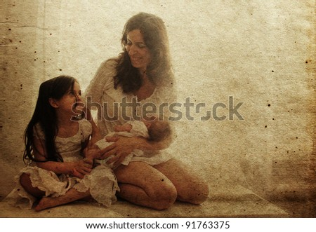 young mother with two her daughters. Photo in old color image style.
