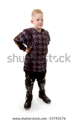 Young motor race boy is posing over white background - stock photo