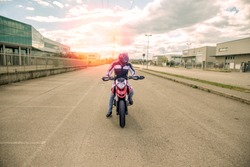 Young motorcycle rider ready to drive on street, enjoying freedon, active lifestyle, having fun.