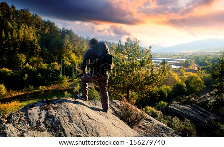 young mountainer look in to beautiful colorful sunset- HDR adventure landscape
