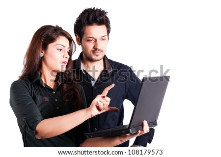 young multi racial couple using laptop isolated on white