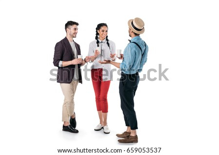 young multiethnic friends talking while drinking coffee from plastic cups isolated on white