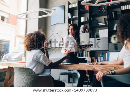 young multiracial businesswomen having informal talk in coworking office – interaction, creativity, inventive Stock photo ©