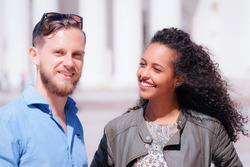 Young multiracial couple with arabic girl and Dutch man smiling as part of diversity friendship and togetherness concept