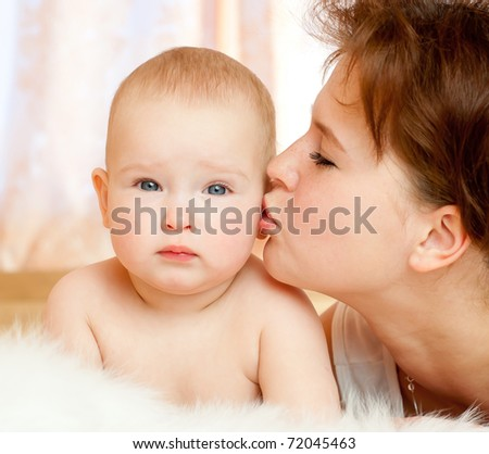 Young mum and the babe in a bedroom