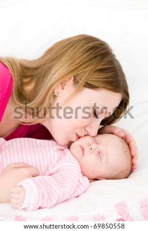 Young mum embraces the falling asleep chest baby