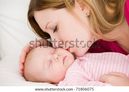 Young mum embraces the falling asleep chest baby - stock photo