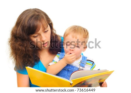 Young mum is reading a book with her cute son