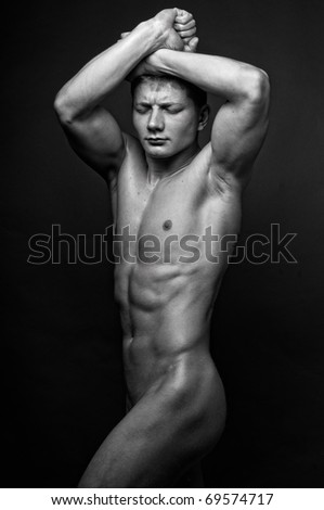Young muscled model posing in studio