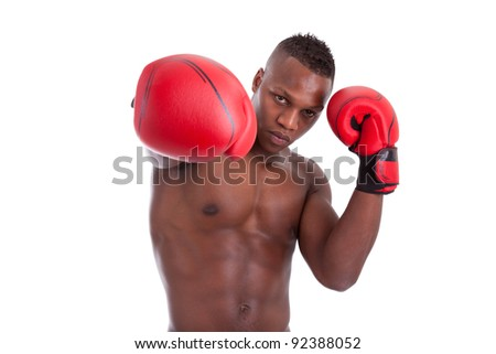 Stock photo young muscular african american man with boxing gloves