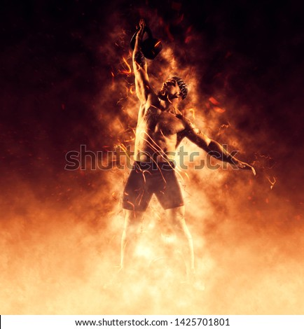 Young muscular man training with kettlebells. Photo of man with naked torso on flame background. Strength and motivation