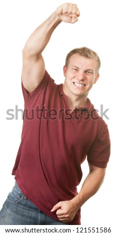 Young muscular white adult male celebrating with fist in the air