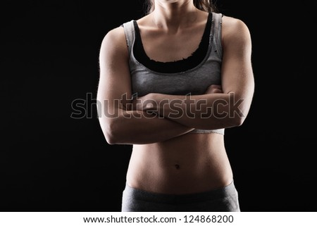 Young muscular woman in exercise clothing