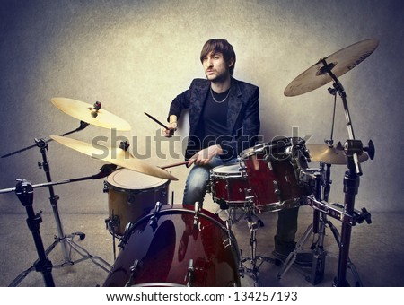 young musician playing drums