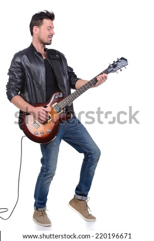 Young musician playing guitar, isolated on white Сток-фото ©