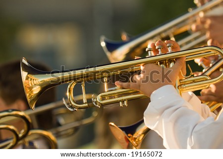 young musicians are playing on trombones