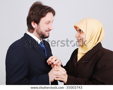 Young muslim couple looking at each other