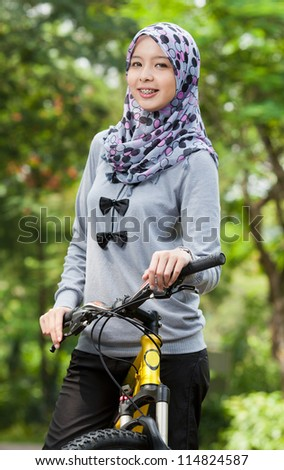 Young Muslim girl on bicycle