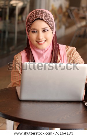 young muslim girl with laptop
