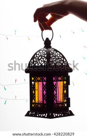 Young Muslim kid hand holding Ramadan lantern