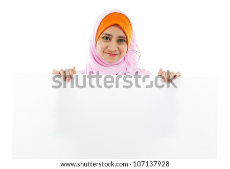 Young Muslim woman holding a white board
